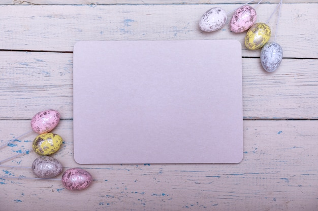 Easter eggs painted in pastel colors on a white cracked antique background with copy space for text.