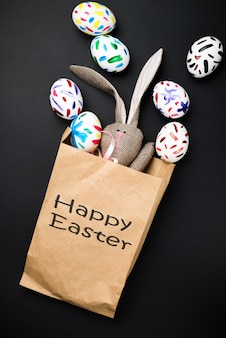 Easter eggs in a paper bag and a bunny