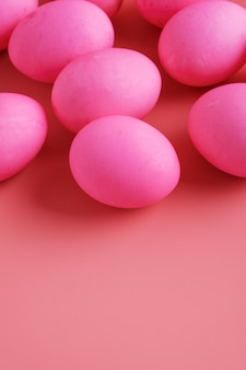 Easter eggs on pink background, vertical, copy space
