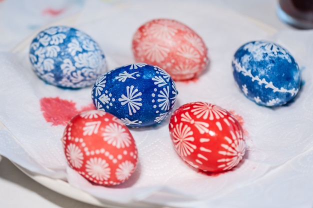 Easter eggs in plate. the process of painting eggs. ready. easter holiday concept.