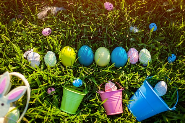 Easter eggs in a row hidden in spring grass