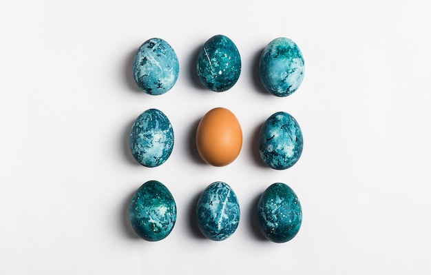 Easter eggs row isolated painted by handin blue