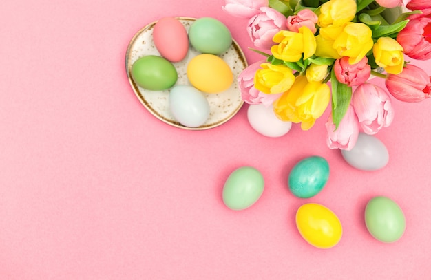 Easter eggs spring tulip flowers decoration pink background