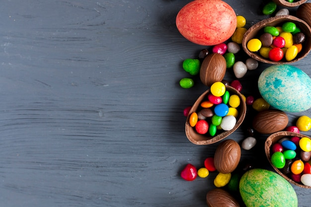 Easter eggs and sweets on gray