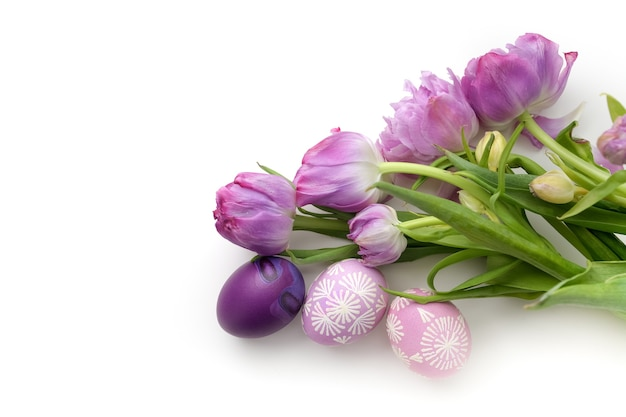 Easter eggs and tulips isolated