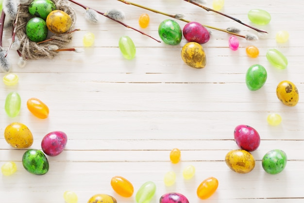 Easter eggs on white wooden backgound