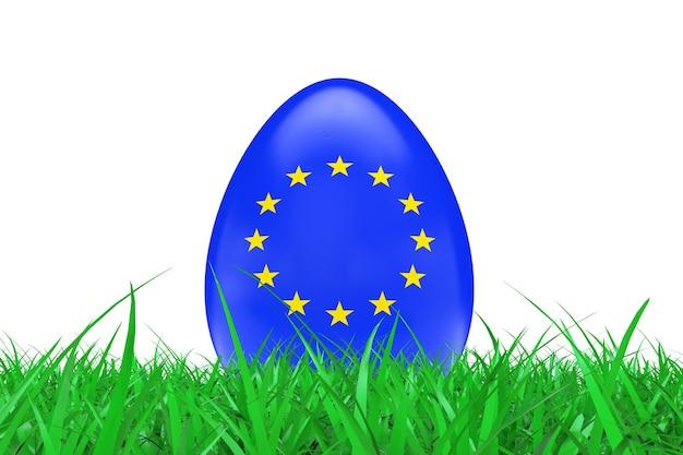 白い背景の上の緑の草の欧州連合の旗とイースターエッグ。 3dレンダリング。