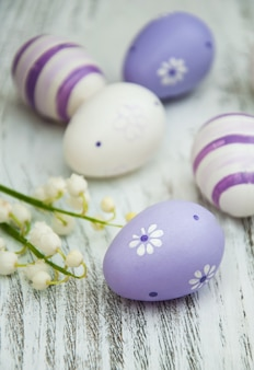 Easter eggs with lily of the valley