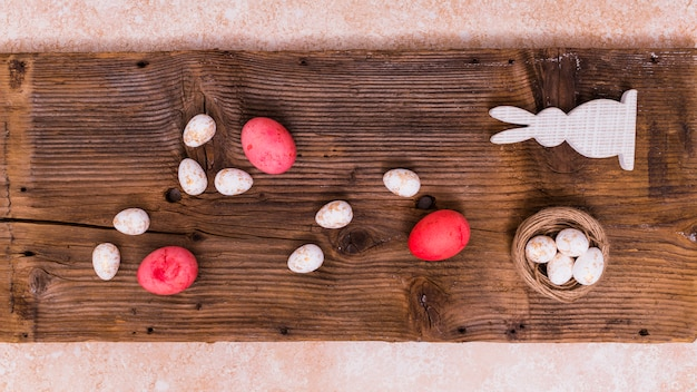 Easter eggs with rabbit on table