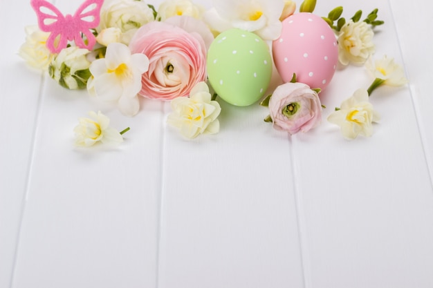 Easter eggs with ranunculus flowers