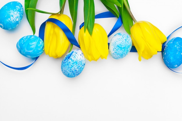 Easter eggs with tulips flowers