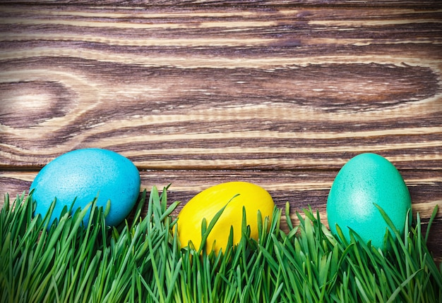 Easter eggs on wooden board