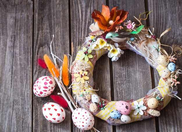 Easter eggs wreath on a wooden background