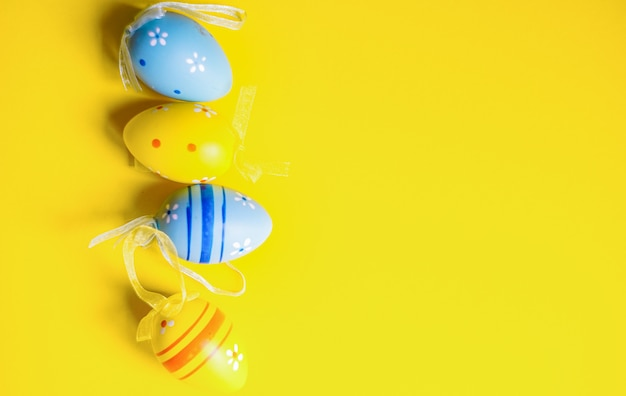 Easter eggs on yellow background