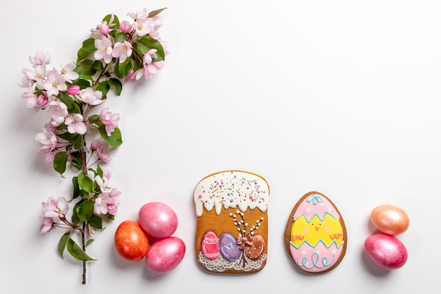 Easter festive arrangement in row of gingerbreads, colored eggs
