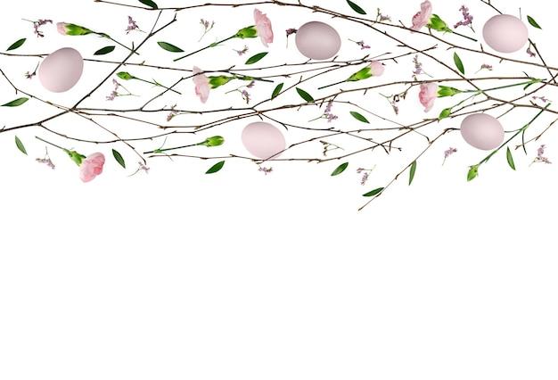 イースターの花の構成。カーネーションで作られたパターン。フラットレイ、上面図。