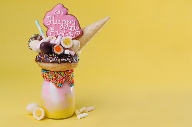 Easter freak shake on yellow background with copy space