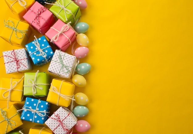 Easter gifts on yellow background