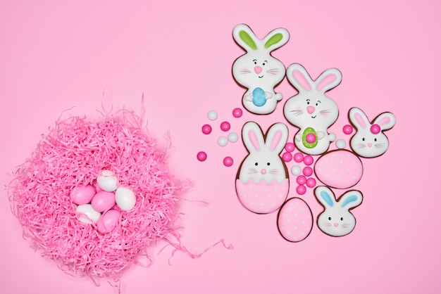 Easter ginger cookies, candies eggs in nest.