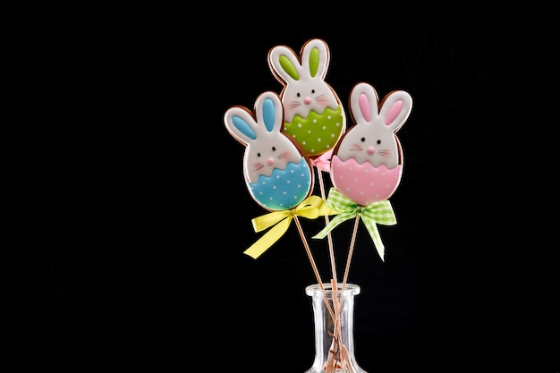 Easter gingerbread bunnies with colorful icing on stick