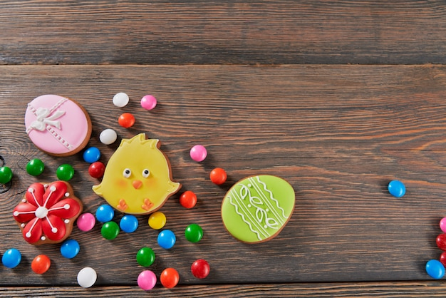Easter gingerbread chickens and eggs on wooden table