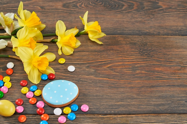 Easter glazed cookies, chocolate balls and daffodils.