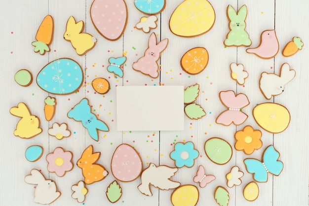 Easter greeting card with gingerbread cookies.  egg shaped cookies and easter bunny.