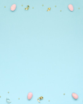 Easter holiday background with pink easter eggs and golden ribbons. copy space