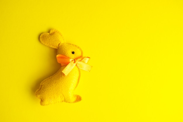 Easter holiday bunny toy on yellow background