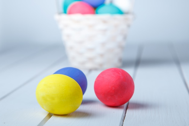 Easter, holidays, tradition and object concept ãƒâã'â²ãƒâã'â'ãƒâ¢ã'â€ã'❠close up of colored easter eggs on wooden surface