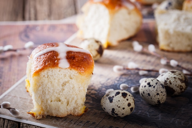 Easter hot cross buns on wooden background