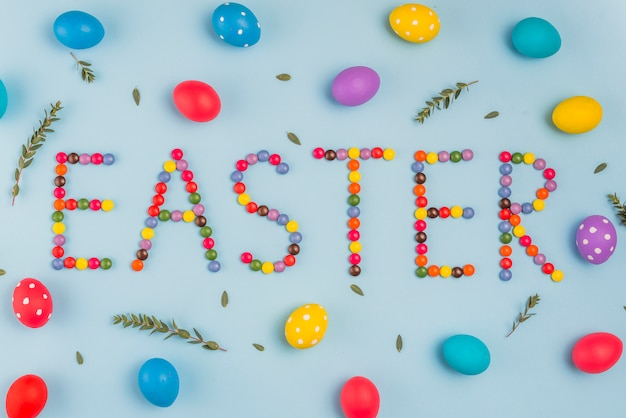 Easter inscription from candies with colored eggs