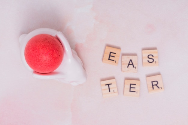 Easter inscription with red egg in cup