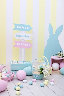 Easter! many colorful easter eggs with bunnies and baskets of flowers! children's room for games, a family holiday. spring and easter room decor. colorful easter room interior. colorful   bunnies