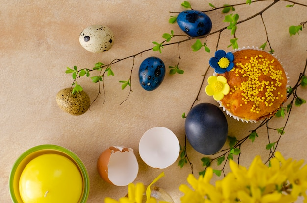Easter muffins, yellow flowers  and blue easter quail eggs