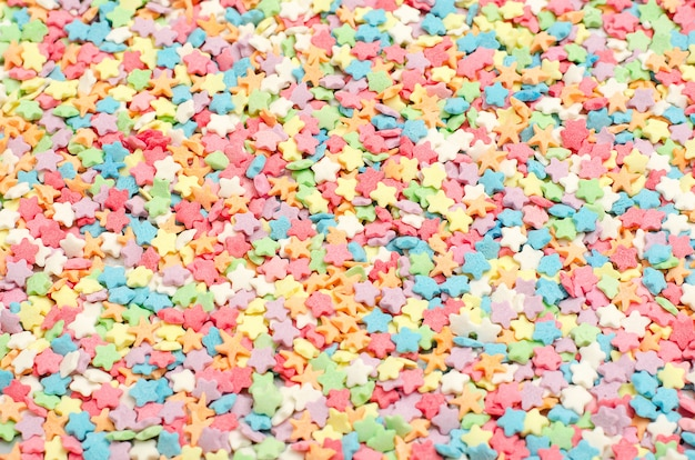 Easter multicolored confectionery topper background top view