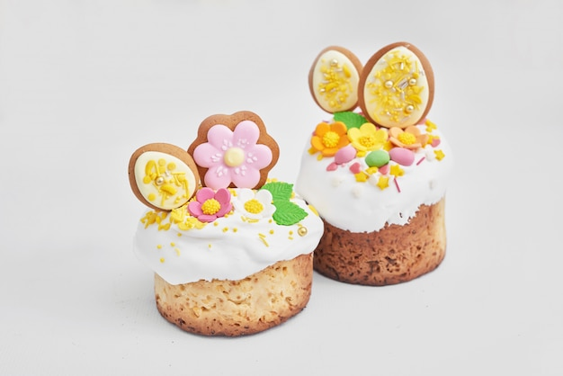 Easter orthodox sweet bread, easter cake with flowers and gingerbread. holidays breakfast concept with copy space.