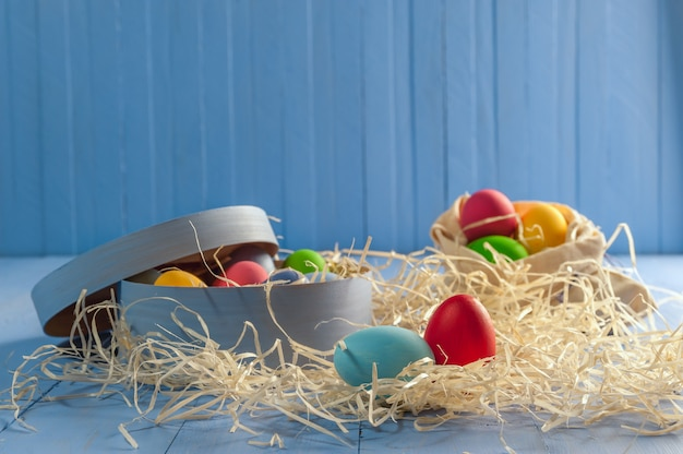 Easter painted egg on wooden rustic table, holiday surface for your decoration. decoupage eggs on colorful boards