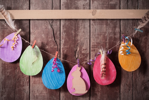 Easter paper eggs on wooden background