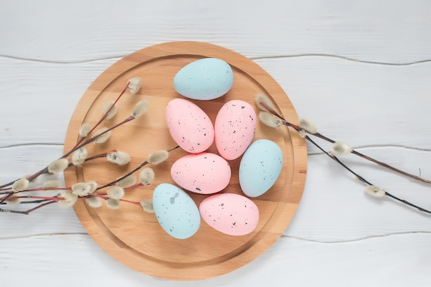 Easter pastel eggs on a wooden board
