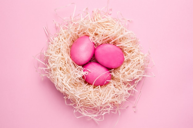 Easter pink eggs on a pink surface