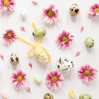 Easter quail eggs and flower