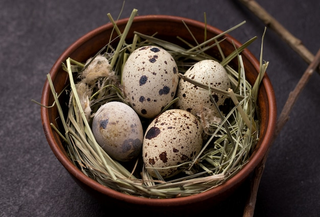 Easter quail eggs in the hay