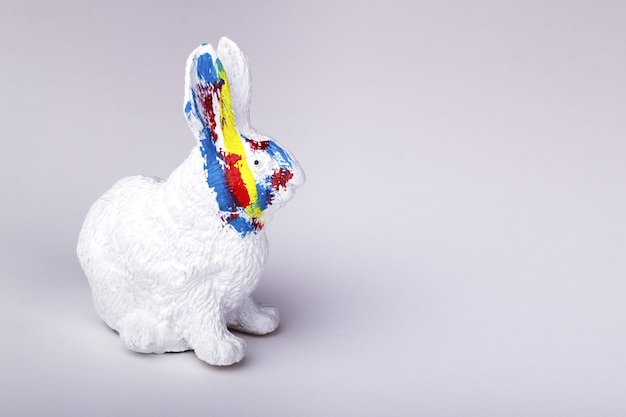 Easter rabbit with color strokes on a  white background, a card for the easter holidays