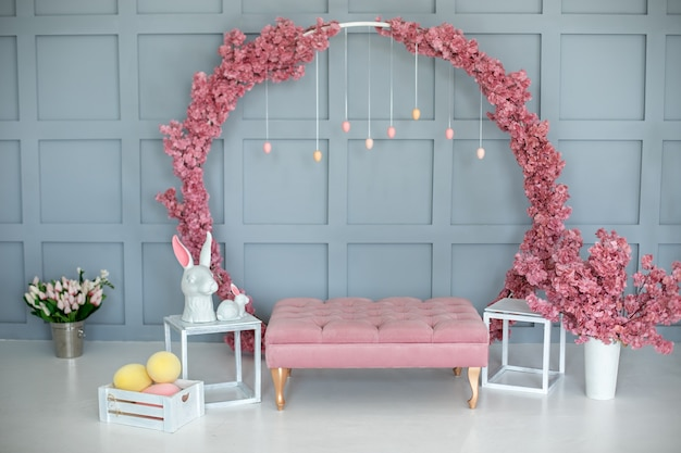 Easter room pink decoration with rabbits and eggs.