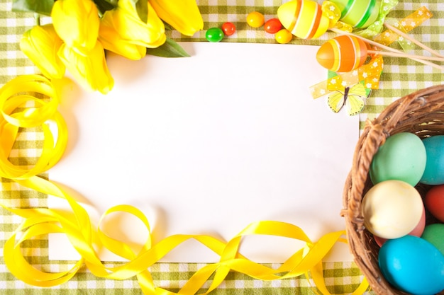 Easter set frame with clear white sheet, eggs in a basket.