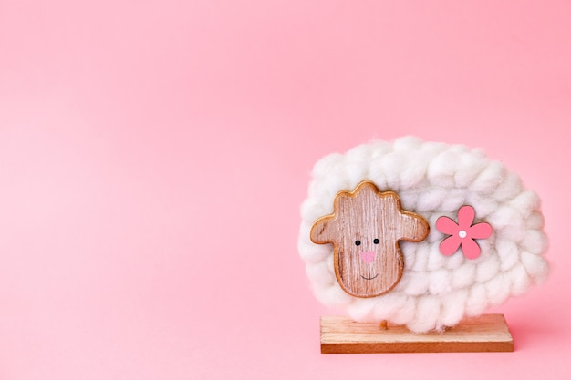 Easter sheep decoration on pink background