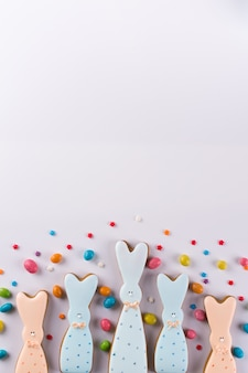 Easter spring decorative composition. cookies in the shape of funny bunny and colored sprinkles