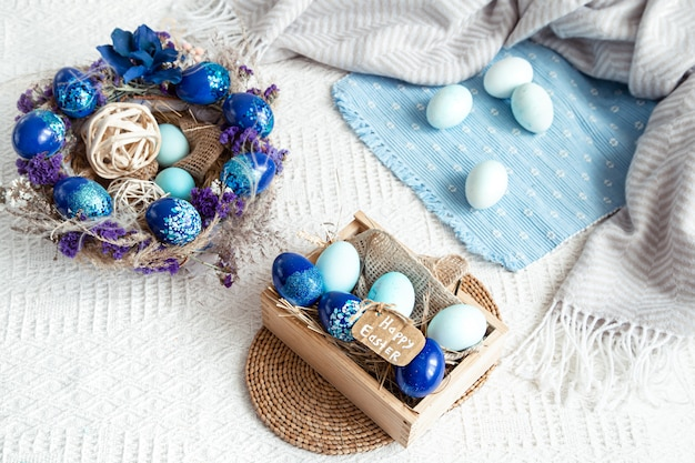 Easter still life with blue eggs, holiday decor .