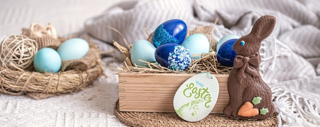 Easter still life with blue eggs, holiday decor